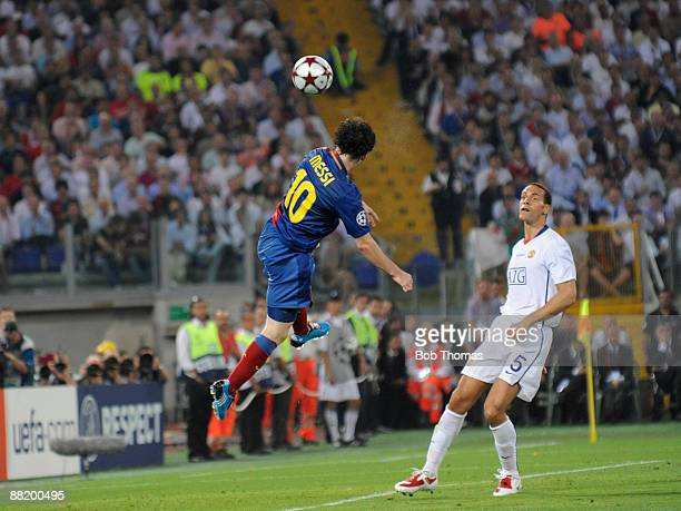 Lionel Messi of Barcelona scores the 2nd goal watched by Rio Ferdinand of Manchester United during the UEFA Champions League Final match between...