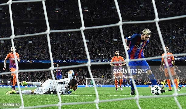 Lionel Messi of Barcelona scores the opening goal of the game during the UEFA Champions League group C match between FC Barcelona and Manchester City...