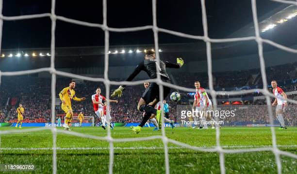 Lionel Messi of Barcelona scores the opening goal past goalkeeper Ondrej Kolar of Slavia Praha during the UEFA Champions League group F match between...
