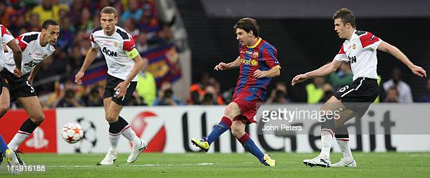 Lionel Messi of Barcelona scores their second goal during the UEFA Champions League Final match between Barcelona and Manchester United at Wembley...