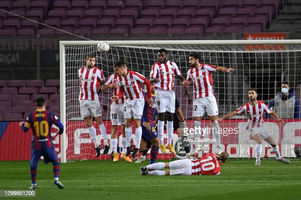 Lionel Messi of Barcelona scores their side's first goal from a free kick during the La Liga Santander match between FC Barcelona and Athletic Club...