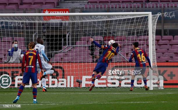 Lionel Messi of Barcelona scores their team's first goal during the La Liga Santander match between FC Barcelona and Valencia CF at Camp Nou on...