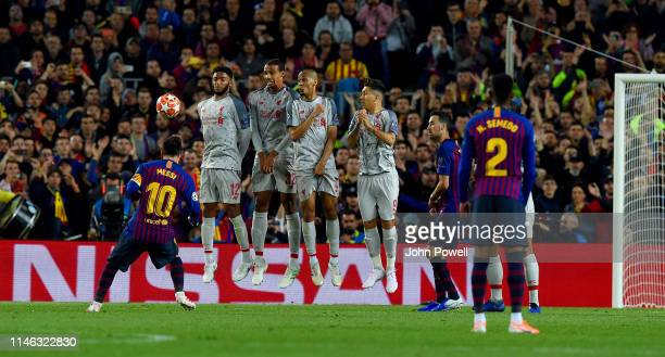 Lionel Messi of Barcelona scoring a free kick during the UEFA Champions League Semi Final first leg match between Barcelona and Liverpool at the Nou...