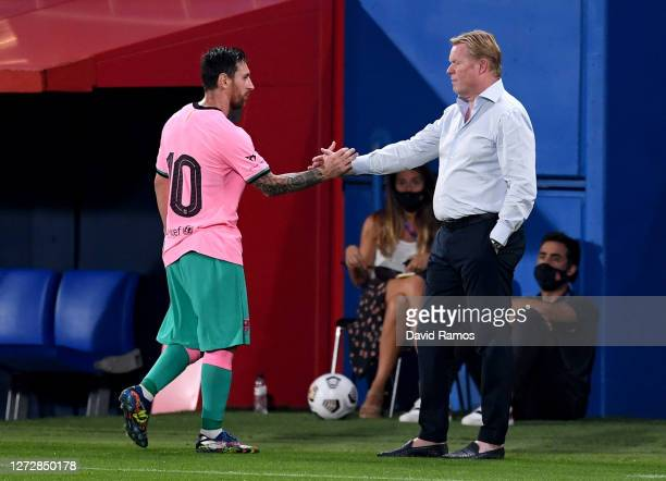 Lionel Messi of Barcelona shakes hands with Ronald Koeman, Manager of FC Barcelona after he is substituted during the pre-season friendly match...