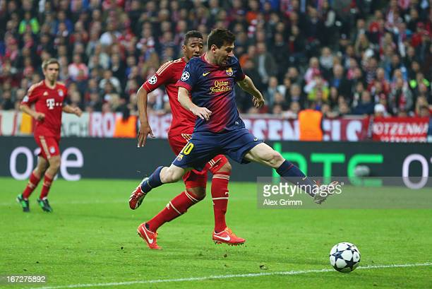 Lionel Messi of Barcelona shoots at goal under pressure from Jerome Boateng of Bayern Muenchen during the UEFA Champions League Semi Final First Leg...