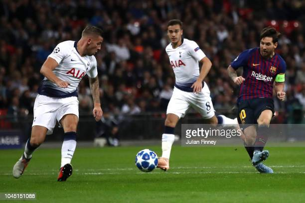 Lionel Messi of Barcelona shoots during the Group B match of the UEFA Champions League between Tottenham Hotspur and FC Barcelona at Wembley Stadium...
