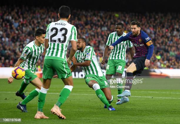 Lionel Messi of Barcelona shoots during the La Liga match between FC Barcelona and Real Betis Balompie at Camp Nou on November 11 2018 in Barcelona...