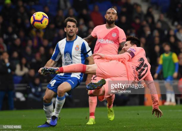 Lionel Messi of Barcelona shoots during the La Liga match between RCD Espanyol and FC Barcelona at RCDE Stadium on December 8 2018 in Barcelona Spain