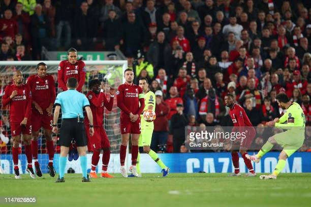 Lionel Messi of Barcelona shoots from a free kick during the UEFA Champions League Semi Final second leg match between Liverpool and Barcelona at...