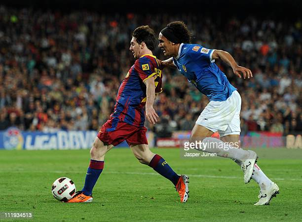 Lionel Messi of Barcelona shoots to score his second goal besides Marcelo Silva of Almeria during the la Liga match between FC Barcelona and UD...