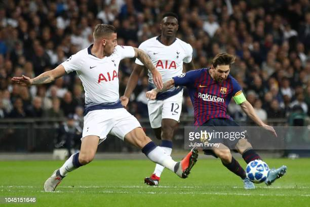 Lionel Messi of Barcelona shoots under pressure from Toby Alderweireld of Tottenham Hotspur during the Group B match of the UEFA Champions League...
