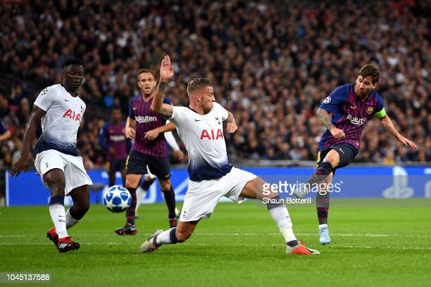 Lionel Messi of Barcelona shoots while under pressure from Toby Alderweireld of Tottenham Hotspur during the Group B match of the UEFA Champions...
