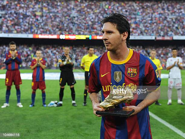 Lionel Messi of Barcelona shows his European Golden Boot award prior to the start of the La Liga match between Barcelona and Mallorca at the Camp Nou...
