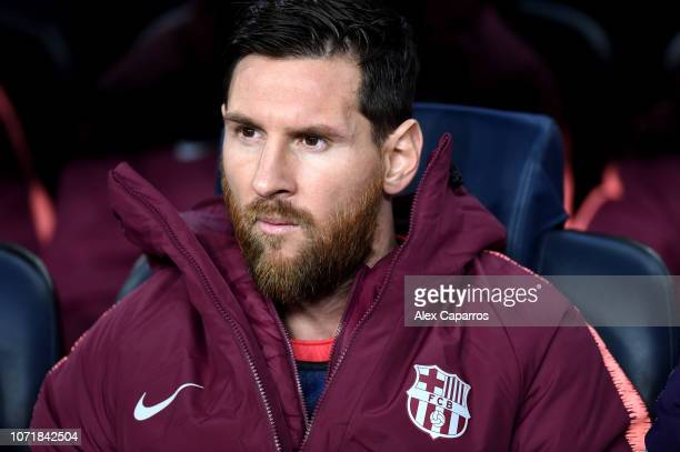 Lionel Messi of Barcelona sits on the bench prior to the UEFA Champions League Group B match between FC Barcelona and Tottenham Hotspur at Camp Nou...