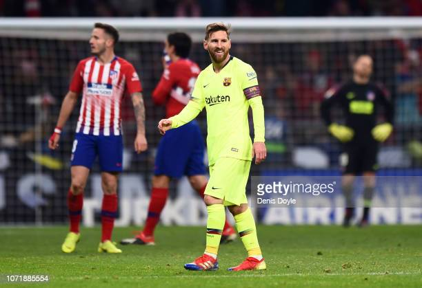 Lionel Messi of Barcelona smiles after their late equalising goal during the La Liga match between Club Atletico de Madrid and FC Barcelona at Wanda...