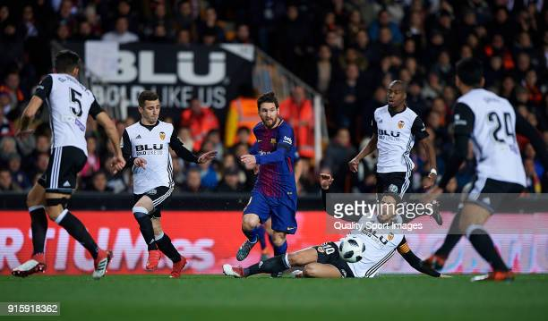 Lionel Messi of Barcelona surrounded by players of Valencia during the Semi Final Second Leg match of the Copa del Rey between Valencia CF and FC...