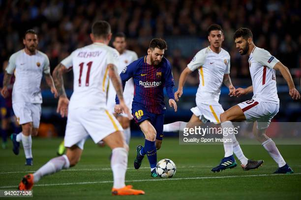 Lionel Messi of Barcelona surrounded by Roma players during the UEFA Champions League Quarter Final first leg match between FC Barcelona and AS Roma...