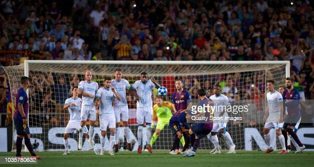 Lionel Messi of Barcelona takes a free kick during the Group B match of the UEFA Champions League between FC Barcelona and PSV at Camp Nou on...