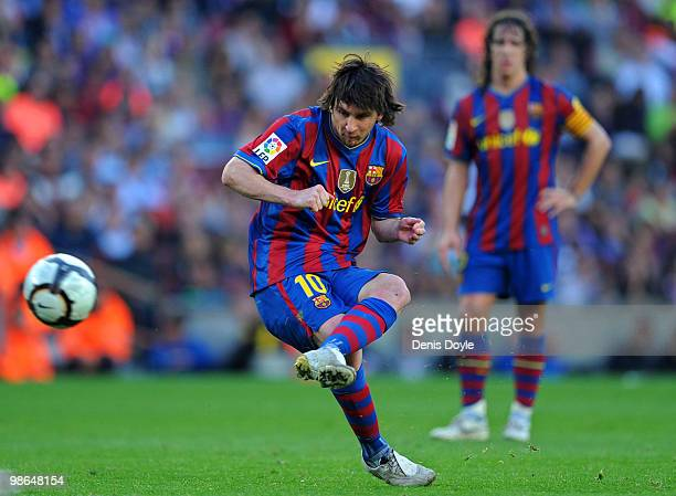 Lionel Messi of Barcelona takes a free kick during the La Liga match between Barcelona and Xerez CD at Camp Nou stadium on April 24, 2010 in...