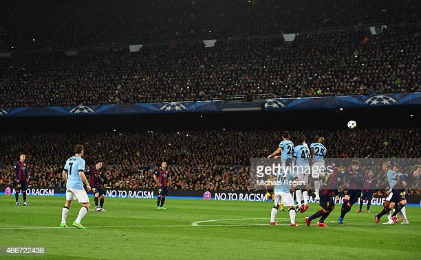 Lionel Messi of Barcelona takes a free kick during the UEFA Champions League Round of 16 second leg match between Barcelona and Manchester City at...