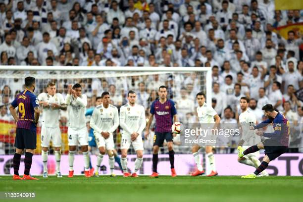 Lionel Messi of Barcelona takes a free-kick during the La Liga match between Real Madrid CF and FC Barcelona at Estadio Santiago Bernabeu on March...