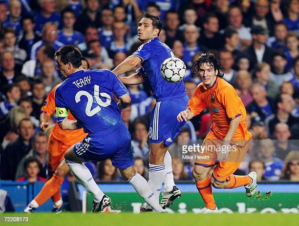 Lionel Messi of Barcelona takes on Frank Lampard and John Terry of Chelsea during the UEFA Champions League Group A match between Chelsea and...