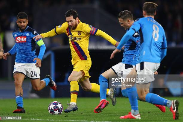 Lionel Messi of Barcelona takes on Piotr Zielinski and Lorenzo Insigne of Napoli during the UEFA Champions League round of 16 first leg match between...