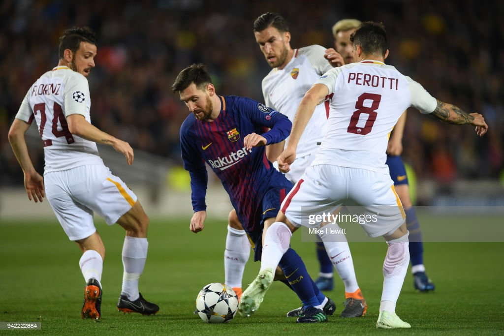 Lionel Messi of Barcelona takes on the Roma defence during the UEFA Champions League Quarter Final Leg One between FC Barcelona and AS Roma at Camp Nou on April 4, 2018 in Barcelona, Spain.
