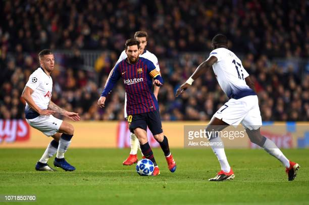 Lionel Messi of Barcelona takes on Toby Alderweireld and Moussa Sissoko of Tottenham Hotspur during the UEFA Champions League Group B match between...