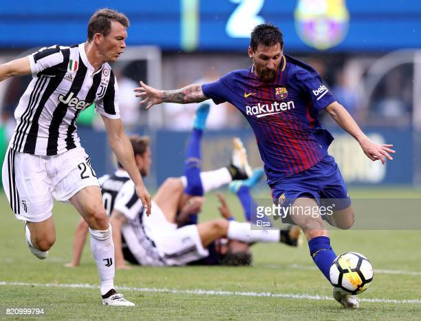 Lionel Messi of Barcelona takes the ball as Stephan Lichtsteiner of Juventus defends during the International Champions Cup 2017 on July 22 2017 at...