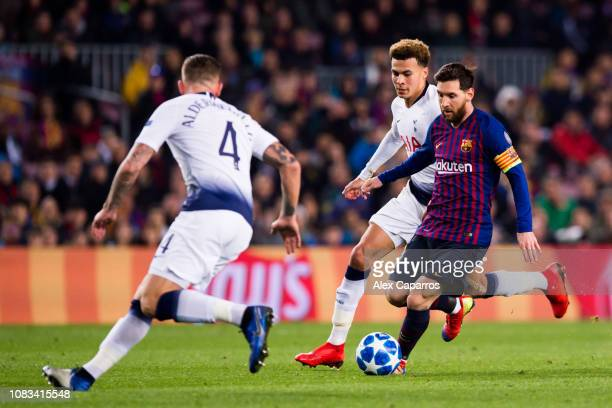 Lionel Messi of Barcelona takes the ball past Toby Alderweireld and Dele Alli of Tottenham Hotspur during the UEFA Champions League Group B match...