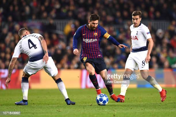 Lionel Messi of Barcelona takes the ball past Toby Alderweireld of Tottenham Hotspur during the UEFA Champions League Group B match between FC...