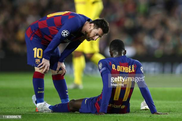 Lionel Messi of Barcelona talks to Ousmane Dembele of Barcelona during the UEFA Champions League group F match between FC Barcelona and Borussia...