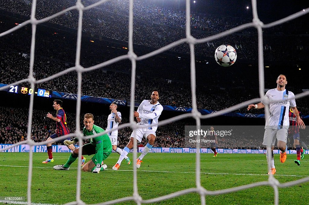 Lionel Messi (L) of Barcelona turns away to celebrate after scoring his team's opening goal during the UEFA Champions League Round of 16, second leg match between FC Barcelona and Manchester City at Camp Nou on March 12, 2014 in Barcelona, Spain.