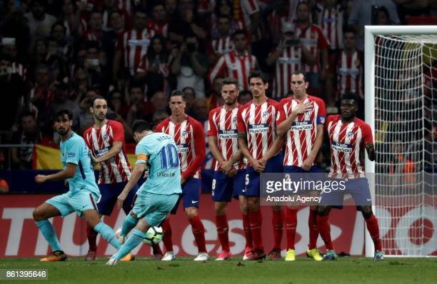 Lionel Messi of Barcelona uses a free kick during the Spanish La Liga match between Atletico Madrid and Barcelona at Wanda Metropolitano Stadium in...