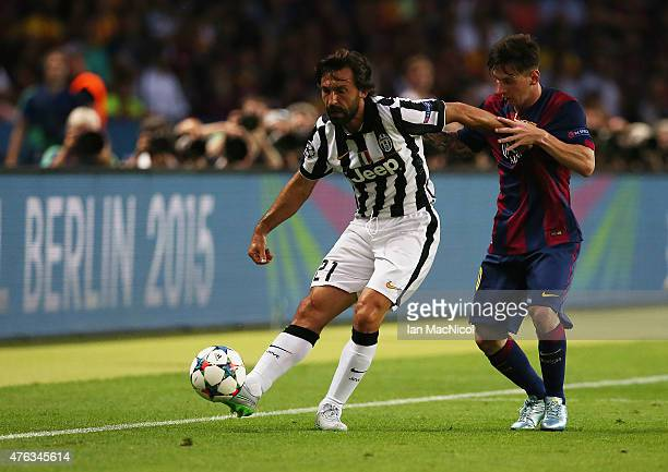Lionel Messi of Barcelona vies with Andrea Pirlol of Juventus during the UEFA Champions League Final between Barcelona and Juventus at Olympiastadion...