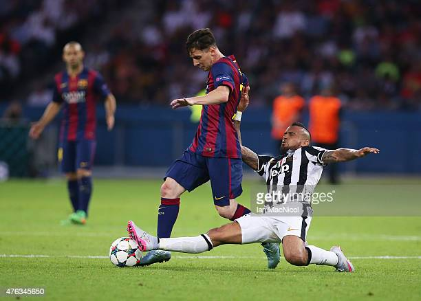 Lionel Messi of Barcelona vies with Arturo Vidal of Juventus during the UEFA Champions League Final between Barcelona and Juventus at Olympiastadion...