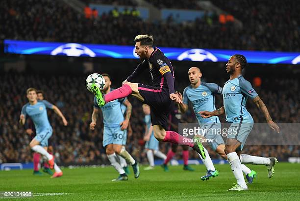 Lionel Messi of Barcelona volleys the ball during the UEFA Champions League match between Manchester City FC and FC Barcelona at Etihad Stadium on...