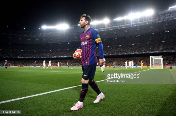 Lionel Messi of Barcelona walks towards the corner flag with the match ball during the UEFA Champions League Quarter Final second leg match between...