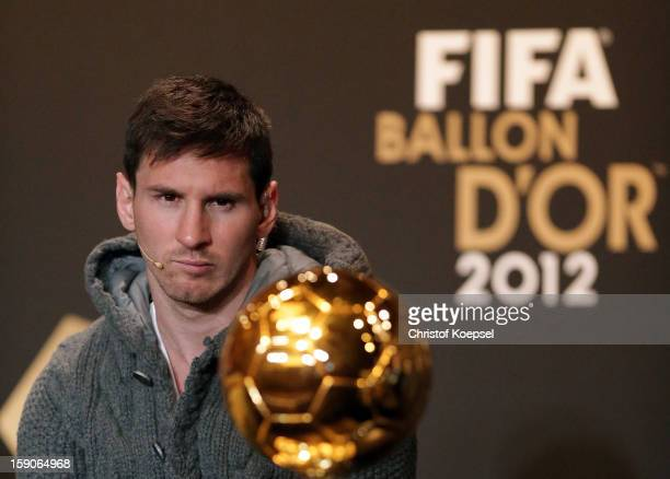 Lionel Messi of Barcelona watches Ballon d'Or trophy during the Press Conference with nominees for World Player of the Year and World Coach of the...
