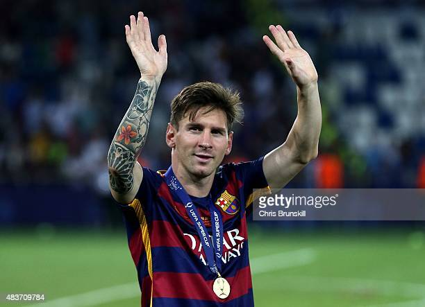 Lionel Messi of Barcelona waves to the supporters following the UEFA Super Cup match between Barcelona and Sevilla FC at Dinamo Stadium on August 11...