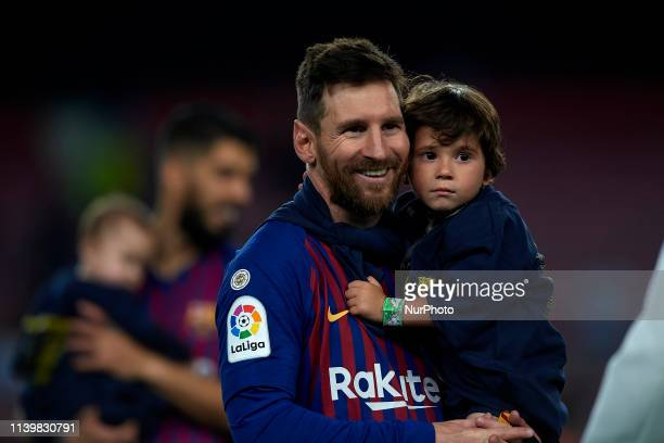 Lionel Messi of Barcelona whit his son celebrate after Barcelona won their 26th league title at the end of the Spanish League football match between...
