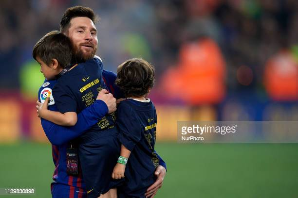 Lionel Messi of Barcelona whit his sons celebrate after Barcelona won their 26th league title at the end of the Spanish League football match between...