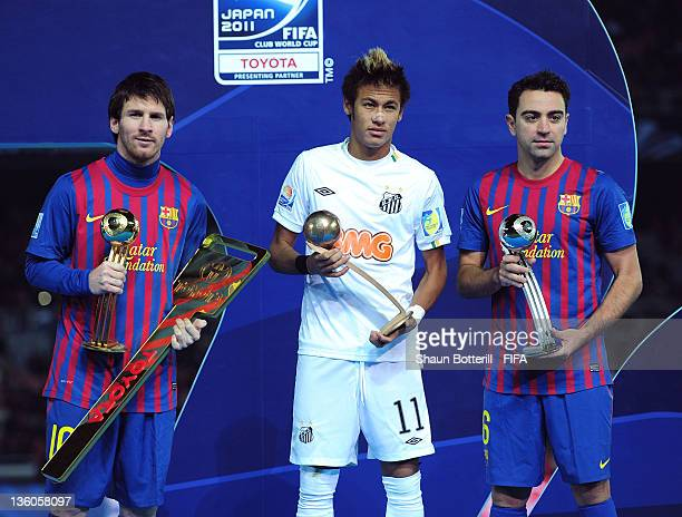 Lionel Messi of Barcelona with the Adidas Golden Ball Award, Neymar of Santos with the Adidas Bronze Ball Award and Xavi of Barcelona with the Adidas...