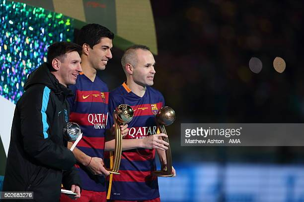 Lionel Messi of FC Barcelona Adidas Silver Ball winner Luis Suarez of FC Barcelona Adidas Gold Ball winner and Andres Iniesta of FC Barcelona Adidas...
