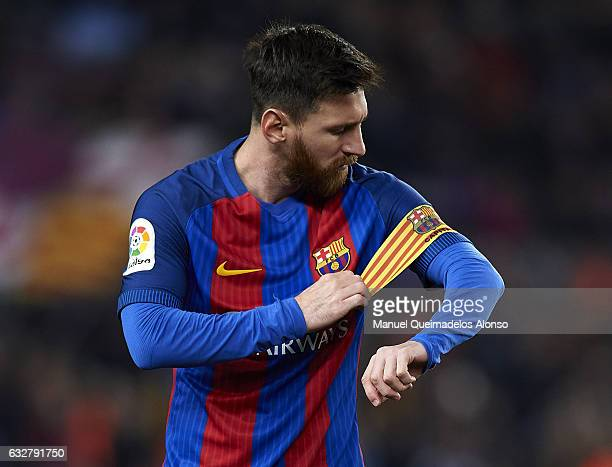 Lionel Messi of FC Barcelona adjusts the captains armband prior to the Copa del Rey quarter-final second leg match between FC Barcelona and Real...
