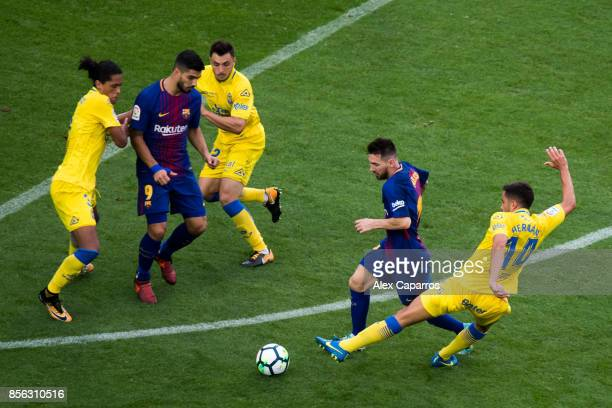 Lionel Messi of FC Barcelona advances with the ball under pressure from Hernan Santana of UD Las Palmas during the La Liga match between Barcelona...