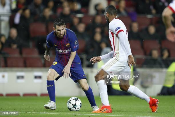 Lionel Messi of FC Barcelona Alaixys Romao of Olympiacos during the UEFA Champions League group D match between FC Barcelona and Olympiacos on...