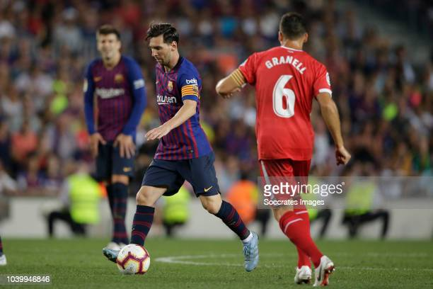 Lionel Messi of FC Barcelona Alex Granell of Girona during the La Liga Santander match between FC Barcelona v Girona at the Camp Nou on September 23...