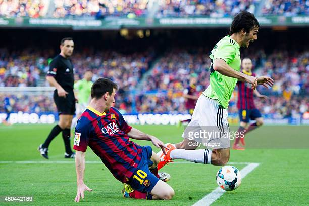 Lionel Messi of FC Barcelona and Alejandro Arribas of CA Osasuna fight for the ball during the La Liga match between FC Barcelona and CA Osasuna at...